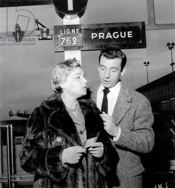 French singer Yves Montand with Simone Signoret before going to Moscow, December 16, 1956, at Orly Airport, Paris (b/w photo)