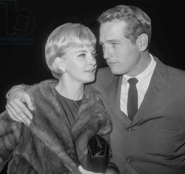 Paul Newman and his wife Joanne Woodward arriving at a reception given for us on the Champs Elysees, Paris, October 13, 1960 (b/w photo)