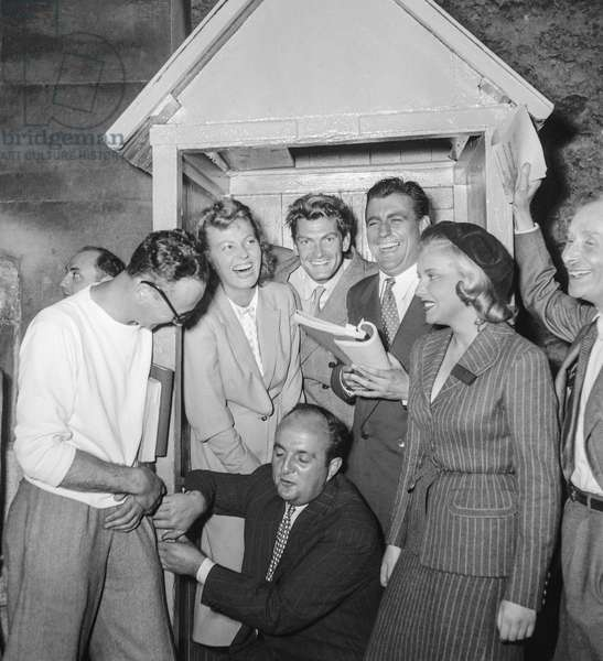 "On set of film ""La souriciere"" on August 31, 1949 : director Henri Calef and actors Junie Astor, Jean Marais, Francois Perier, Daniele Gadet and Bernard Blier (b/w photo)"