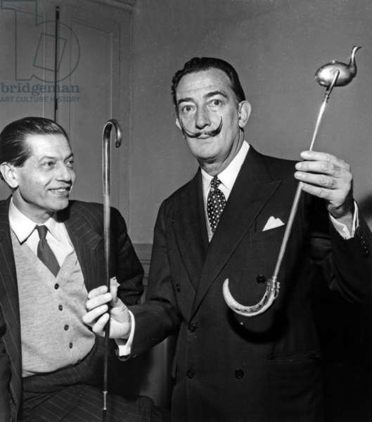 Serge Lifar and Salvador Dali at A Sorbonne Conference, Showing Sticks. Paris, December 17, 1955 (b/w photo)
