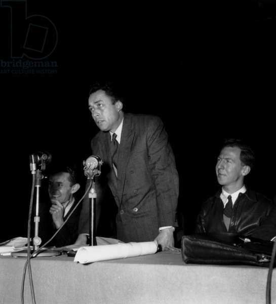 French Writer Albert Camus and Garry Davis during A Meeting in Salle Pleyel, Paris, December 4, 1948 (b/w photo)