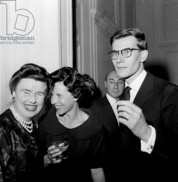 French Dress Designer Yves Saint-Laurent With his Mother and Marguerite Carre July 31, 1958 (b/w photo)