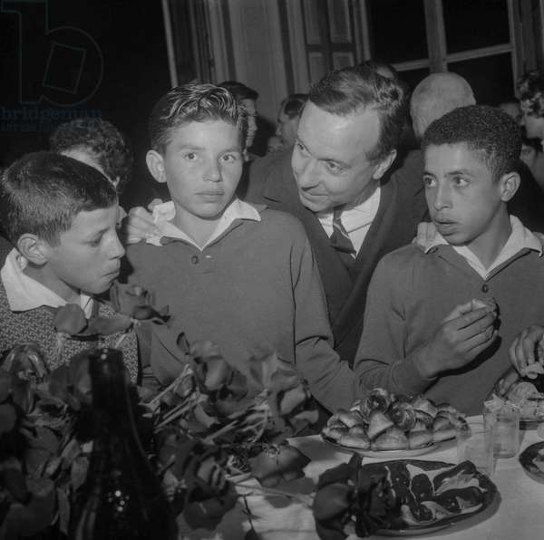 Algerian children (from Arris) having a snack at Matignon, Paris, in presence of Michel Debre September 13, 1960 (b/w photo)