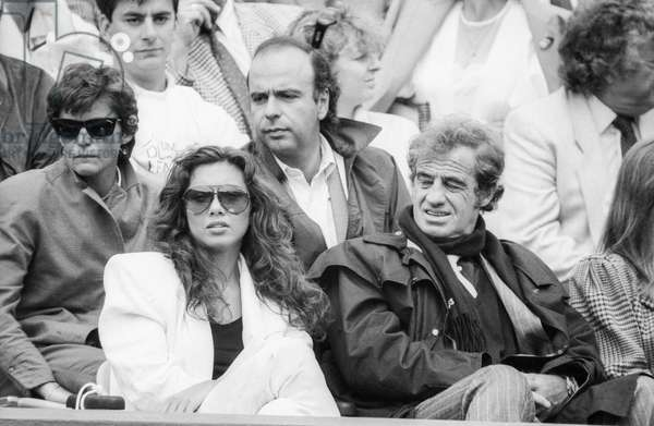 French actor Jean Paul Belmondo attending Roland Garros tennis tournament on June 1, 1987 (b/w photo)