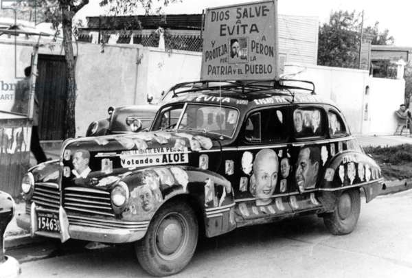 "Electoral Car Carrying Banner ""God Save Evita"" in Support of Eva Peron Who Is About To Be Operated, December 1951, Argentina (b/w photo)"