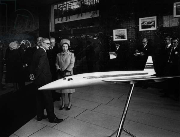 Queen Elizabeth Ii of England and A Model of The Supersonic Passenger Airliner Concorde (British Airways). September 9, 1966. (b/w photo)