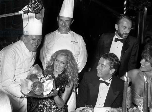 French Singer Dalida with cooks Gaston Lenotre and Paul Bocuse at the Orangery of Versailles Castle, 18 September 1981 (photo)