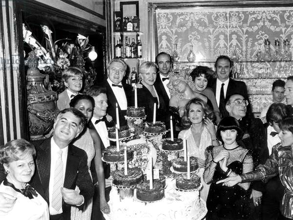 """Jean Claude Brialy, Francoise Dorin, Jean Piat, Line Renaud, Alain Juppe, Andrea Ferreol, Paul Bocuse, Dalida, Yves Mourousi, Mireille Mathieu and Jean Pierre Cassel, at the 10th Anniversary of the Restaurant """"A. Beauvilliers"""", Paris,  28 October 1984 (photo)"""