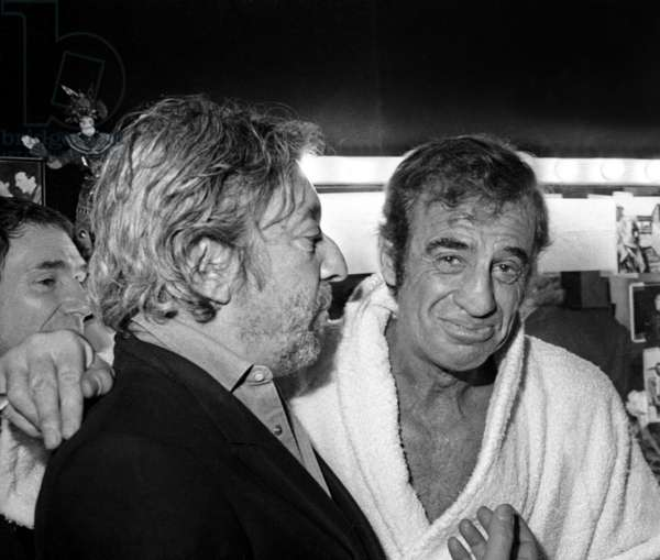 "Serge Gainsbourg congratulating Jean Paul Belmondo after the Premiere of the play ""Kean"", Theatre Marigny, Paris, October 1986 (photo)"
