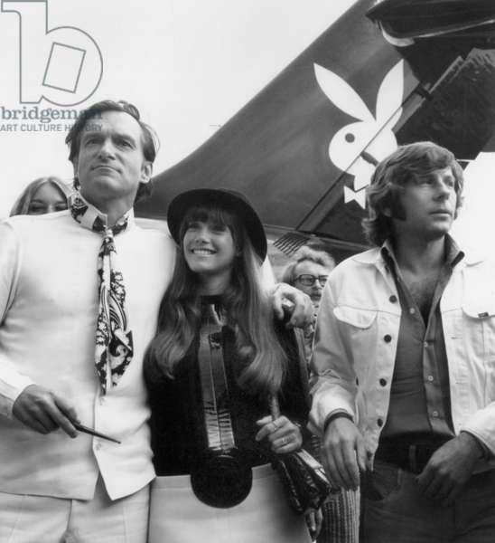 Hugh Hefner with Barbi Benton and Roman Polanski arriving in Paris, 21 August 1970 (photo)