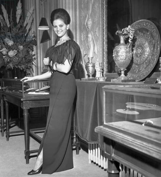 Actress Claudia Cardinale (dress by Yves Saint-Laurent) at opening of the exhibition about Italian Jewels at the Italian Institute in Paris, 7 November 1962  (photo)