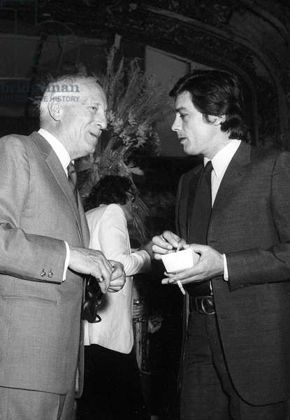 French writer Maurice Bataille and Alain Delon at the L'Alcazar d'Ete  Cafe-Concert, Paris, 10 May 1971 (photo)