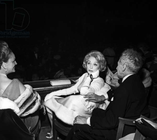 "Marlene Dietrich speaking with Jean Cocteau ann The Begum (Yvette Labrousse) at the Premiere of ""L'opera d'Aran"", Paris, 25 October 1962 (photo)"