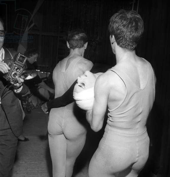 """Dancer Ludmilla Tcherina carried by other dancers in the wings, Ballet by Maurice Bejart """"La dame espagnole et le cavalier romain"""", ParisParis, 18 April 1962 (photo)"""