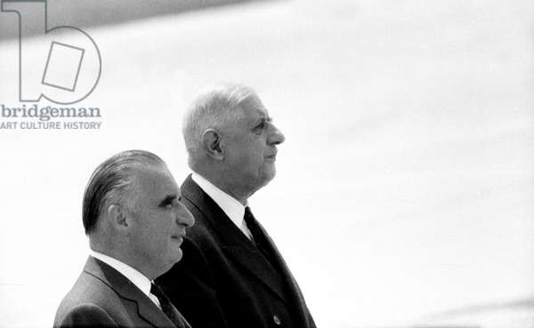 French President Charles de Gaulle with prime minister Georges Pompidou at Orly Airport  Paris, 1 July 1966  (photo)