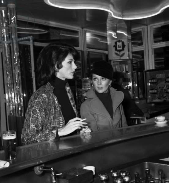 "Anny Duperey and Caroline Cellier in a bar, Paris, after the Premiere of the film ""The Vixen"", 24 October 1969 (photo)"