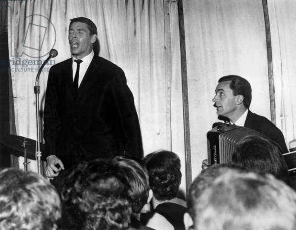 Jacques Brel at Cabaret L'Echelle De Jacob in Paris Jnauary 25, 1965 (b/w photo)