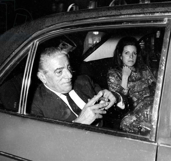 Aristotle Onassis with his daughter Christina in car after Dinner at Maxim's Restaurant, Paris, 22 April 1972 (photo)