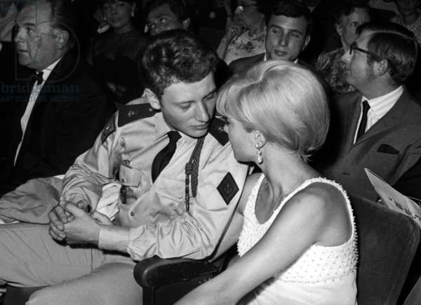 Johnny Hallyday, Sylvie Vartan,  Johnny Stark and Henri Tisotand (behind) at the Premiere of Dalida at the Olympia in Paris, 3 September 1964 (photo)