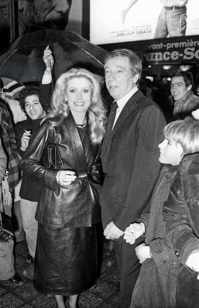 "Catherine Deneuve and Yves Montand at the Premiere of the film ""Le sauvage"" in Paris, 1975 (photo)"