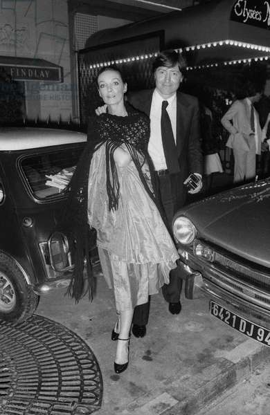 French singer and actress Marie Laforet and her husband arriving at JohnyHallyday's birthday party in Paris, on July 16, 1977
