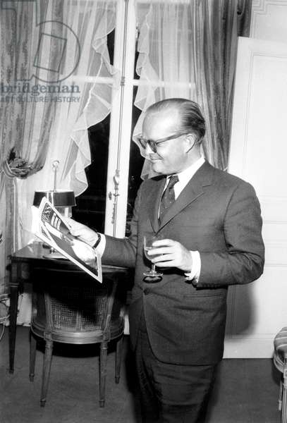 Writer Truman Capote (1924-1984) in his room at the Ritz Hotel in Paris, 1966 (photo)