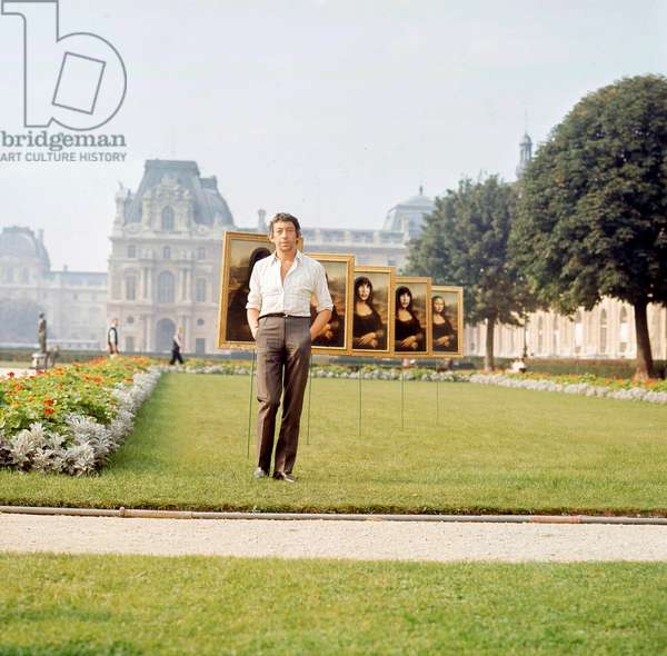 Serge Gainsbourg during the Exhibition of his Paintings at the Tuileries Gardens, Paris, late 1960's (photo)