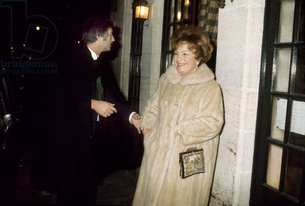 """Magda Schneider (mother of Romy Schneider) and Jean Claude Brialy in front of the restaurant  """"Saint Louis"""" during the wedding of Romy Schneider and Daniel Biasini, 19 December 1975 (photo)"""