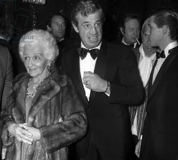 """Jean Paul Belmondo with his mother Sarah and son Paul at the Premiere of the revue """"Cocorico"""" at the Lido, Paris, 1983 (photo)"""