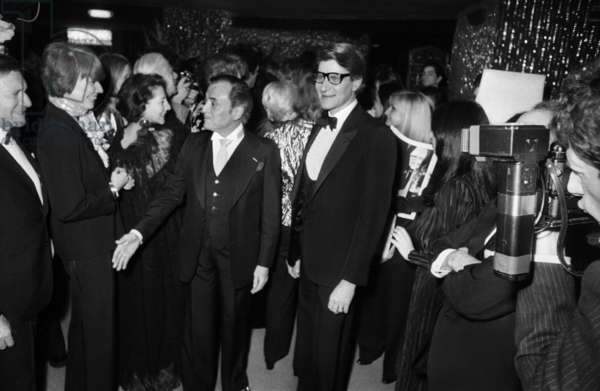 Yves Saint Laurent celebrating at Lido , Paris his 20 years of haute couture with hairdresser Alexandre de Paris, 29 January 1982 (photo)