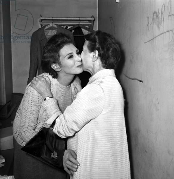 """French writer Simone de Beauvoir congratulating the actress Nathalie Nerval after performance of the play """"Les Bouches inutiles"""", Paris, 16 June 1967 (photo)"""