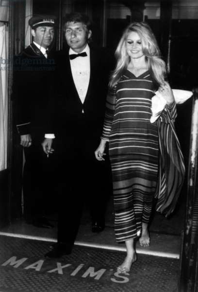 Actress Brigitte Bardot With Husband Gunter Sachs Leaving Maxim'S Restaurant in Paris After The Diner They Offered To 100 Guests May 29, 1967 (b/w photo)