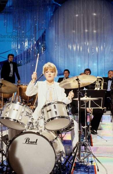 Singer Karen Cheryl on percussion during a TV Programme, June 1980 (photo)