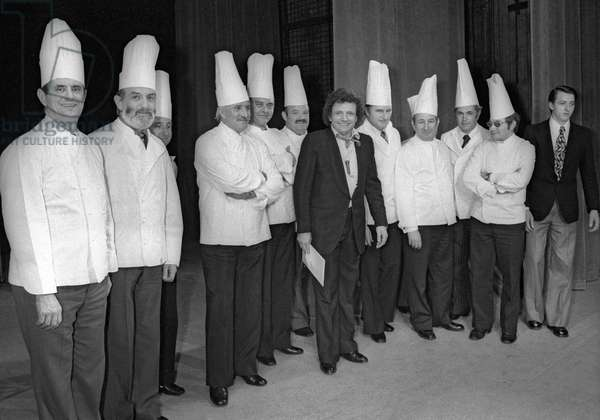 French cook Paul Bocuse visiting Jacques Martin at the Theatre des Varietes in Paris on February 26, 1975 : l-r : Paul Bocuse, Jean Troisgros, Roger Verge, ?, Pierre Troisgros, Jacques Martin (b/w photo)