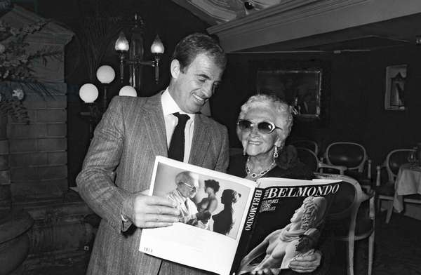 French Actor Jean Paul Belmondo with his mother Madeleine Raynaud Richard at reception given for the album of his father, the sculptor Paul Belmondo in Paris, 28 November 1984  (photo)