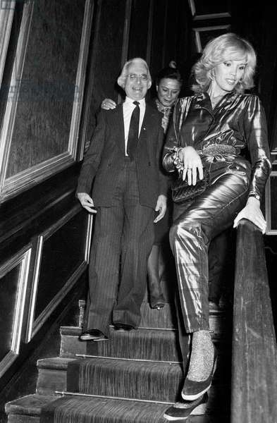 Amanda Lear and writer Roger Peyrefitte at the Opening of a Nightclub in Paris, 4 January 1980 (photo)