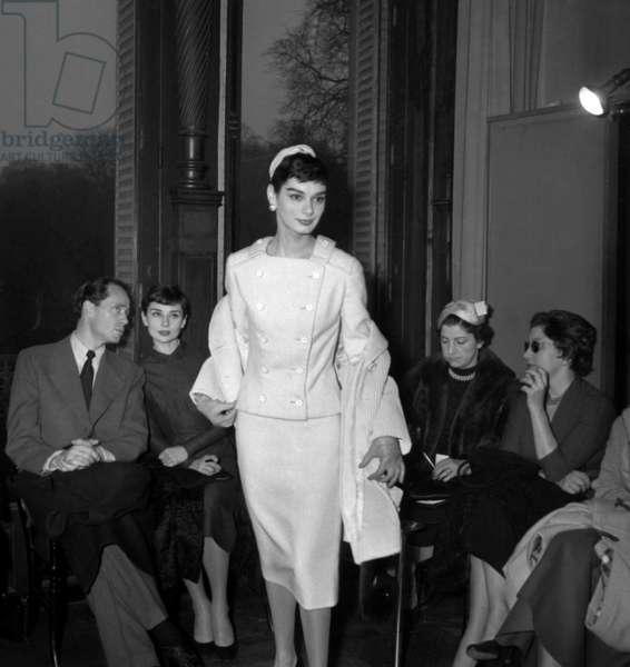 Mel Ferrer and Audrey Hepburn at Givenchy fashion show, Paris, 23 February 1955 (photo)