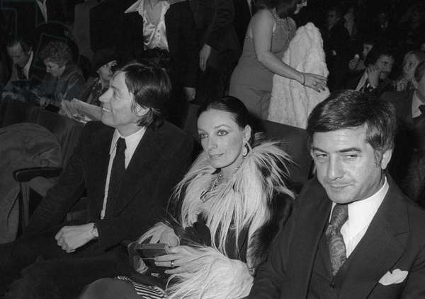 French singer and actress Marie Laforet, French actor Jean Claude Brialy and French art dealer and auctionneer Pierre Cornette de Saint Cyr (left) at CaterinaValente's premiere on January 19, 1976