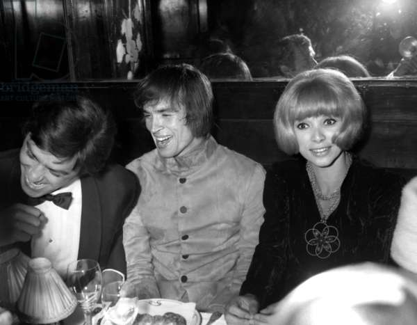 "Alain Delon, Rudolf Noureev and Mireille Darc at Maxim's Restaurant in Paris, after gala of ""Phedre"" at the Olympia, Paris, 15 October 1968 (photo)"