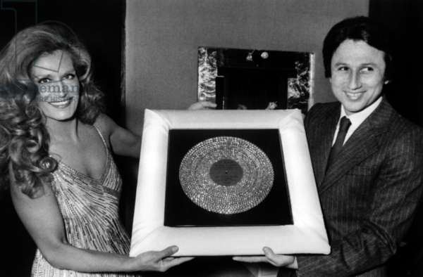 At The Olympia in Paris, Dalida Receiving A Diamond Disc For her 25 Years of Career From Michel Drucker, April 21, 1981 (b/w photo)