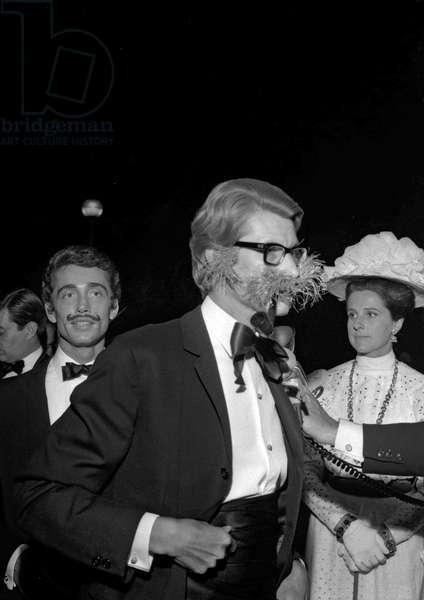 "Yves Saint Laurent at the fancy dress ball on theme ""My fair lady"" june 23, 1965. Restaurant Grande Cascade, Bois de Boulogne, Paris, France (b/w photo)"