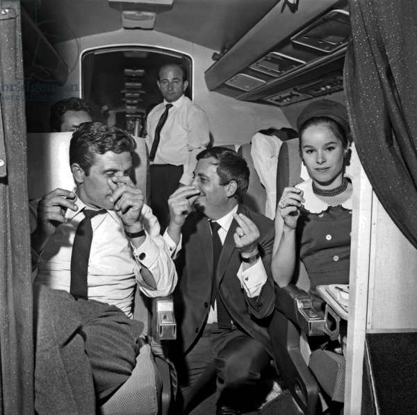 Gilbert Becaud and Geraldine Chaplin on a plane to Beirut for a Charity Ball, 3 July 1964 (photo)