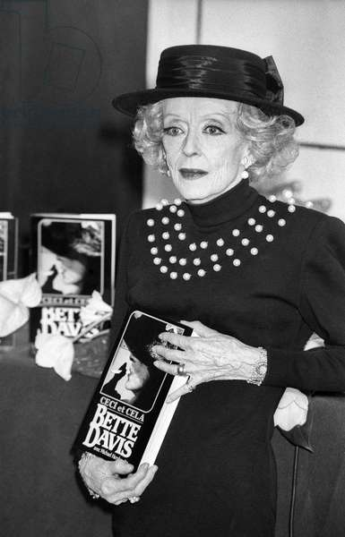 "Actress Bette Davis showing French version of her book ""This 'N That"", Paris, 3 November 1988 (photo)"