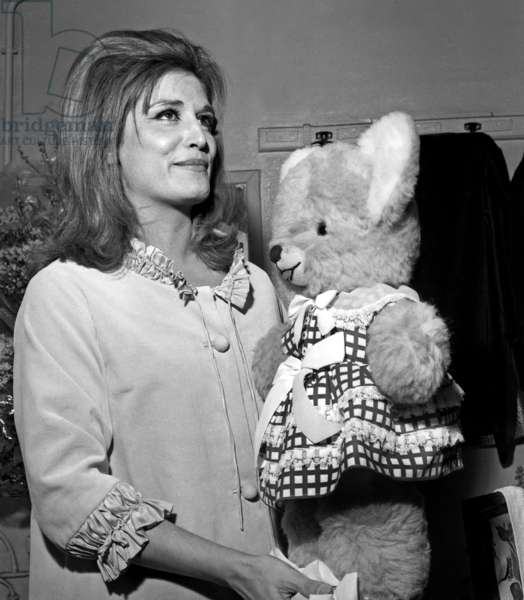 Dalida with a cuddly toy in her dressing room, during the Premiere of Dalida at Bobino, Paris, 3 February 1965 (photo)