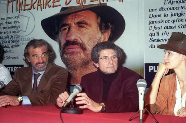 """French Actor Jean Paul Belmondo, director Claude Lelouch and Marie Sophie Pocha arriving at the video cassettes factory """"Fil a film"""", 3 November 1989, France (photo)"""