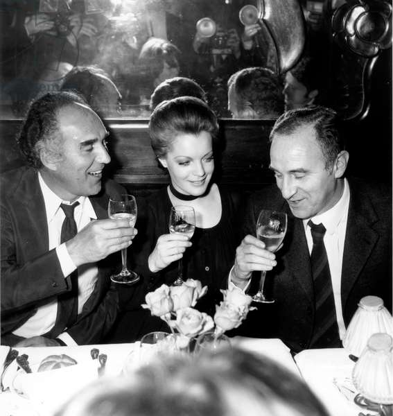 """Claude Sautet with Michel Piccoli and Romy Scnheider at the Restaurant during Premiere of the film """"Max and the Junkmen"""", 16 February 1971 (photo)"""