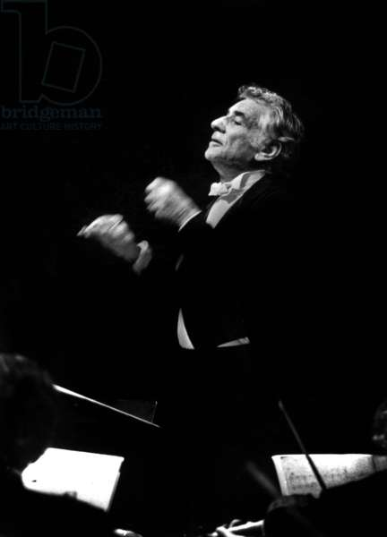 Leonard Bernstein conducting the New York Philarmonic Orchestra, Paris, 18 June 1976 (b/w photo)