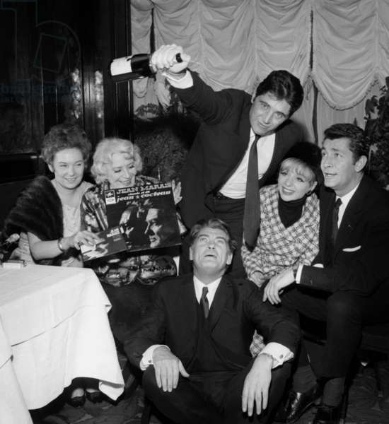 Jean Marais in front of Sacha Distel, Annie Cordy, Jean-Claude Pascal  for the Celebration of the 1st Record of Jean Marais,  Maxim's Restaurant, Paris, 18 January 1966  (photo)