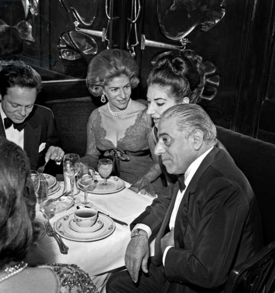 """Baroness Marie Helene de Rothschild, Maria Callas and Aristotle Onassis during Dinner at Maxim's restaunt for the film """"Zorba The Greek"""", 4 March 1965 (photo)"""