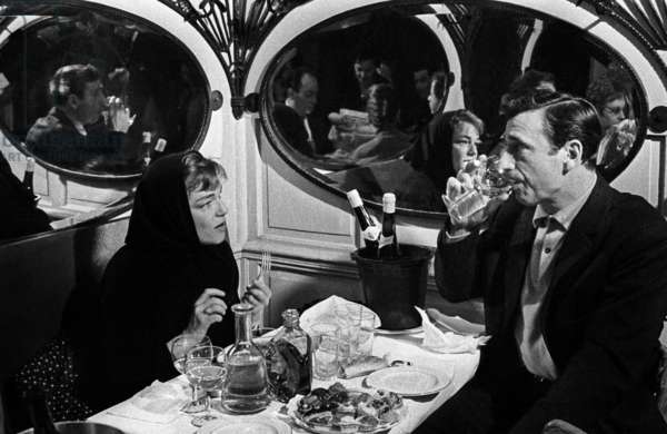 Simone Signoret and Yves Montand celebrating the 100th performance of the show of Yves Montand at the Etoile,  Paris, 12 February 1963 (photo)